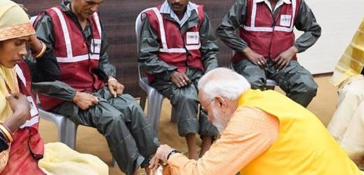 Cleaner's day! Narendra Modi washes feet of sanitation workers. A heartwarming gesture!
